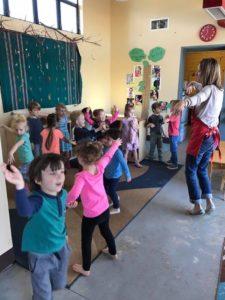 Miss Rachel dances with her students